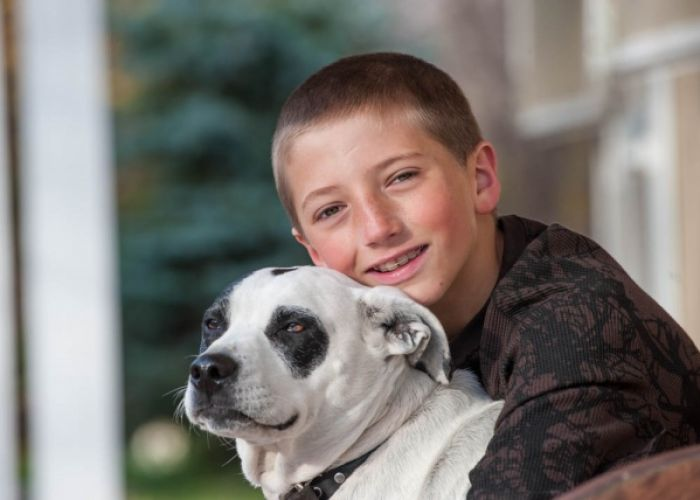 Young Boy Photographed with his Pet Dog